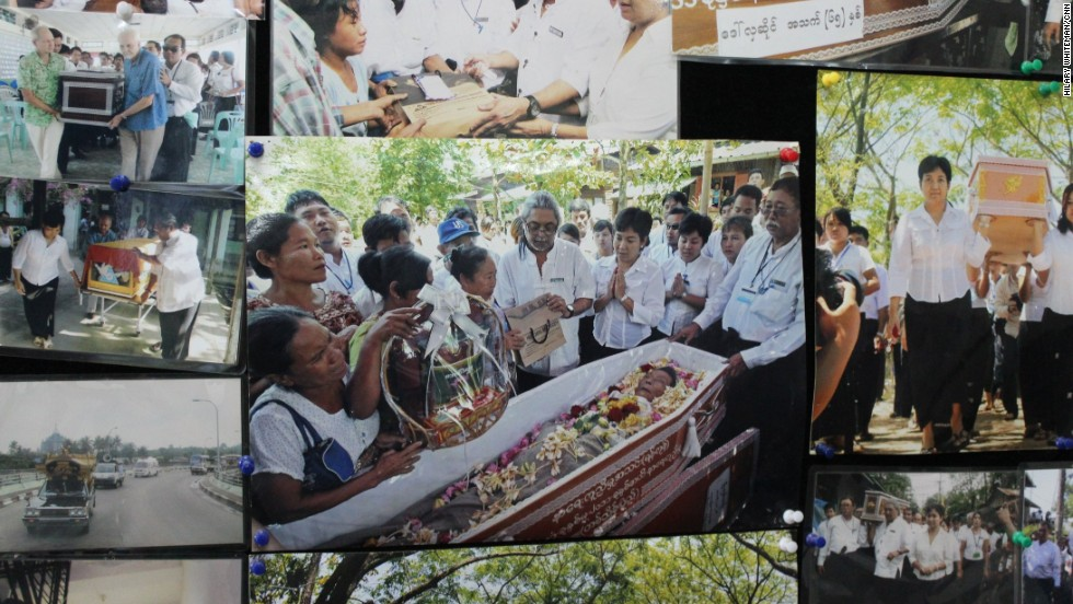 Photos line the walls of the FFSS headquarters. This one shows the 100,000th woman buried by the society which started offering free funeral services in 2001.