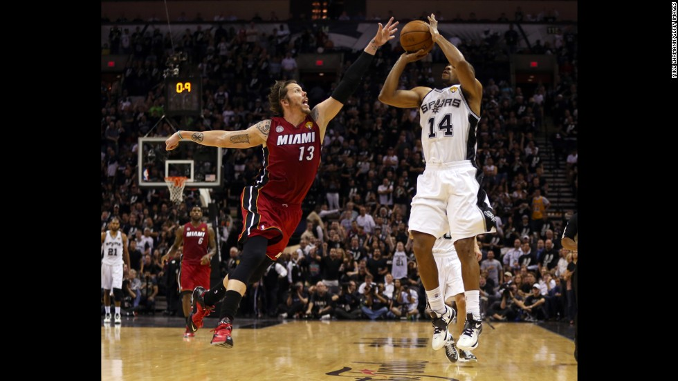 Gary Neal of the San Antonio Spurs makes a three-pointer over Mike Miller of the Miami Heat during the second quarter.