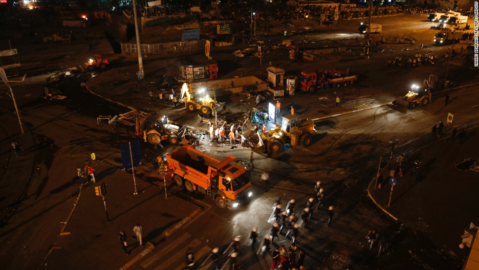 Municipal workers clean up a street in Taksim Square early on June 12, after police moved in to disperse protesters.