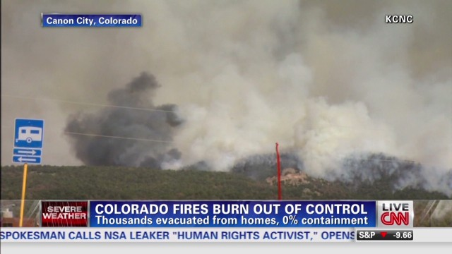 Wildfires force thousands from homes
