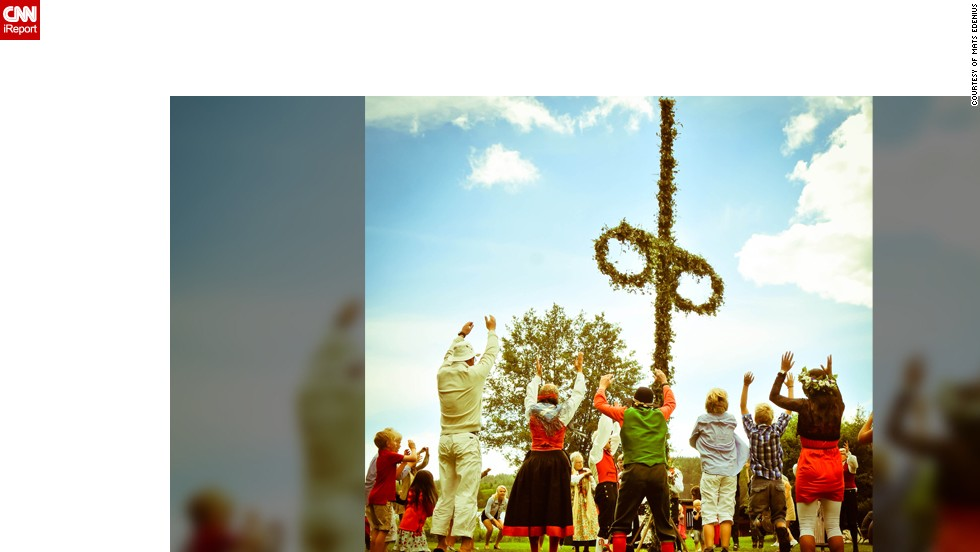 """After the Swedish midsummer maypole has been raised, it's time for the dancing, which, to outsiders, might look odd, embarrassing and weird. But don't laugh! The Swedes take their Midsummer dancing very seriously. This photo, shot by <a href=""""http://ireport.cnn.com/people/MatsEdenius"""" target=""""_blank"""">Mats Edenius</a>, shows the end of the """"rocket"""" dance. """"It starts with low clapping going more intense, trying to make as much noise as possible. Then it takes off and everybody jumps synchronized."""""""