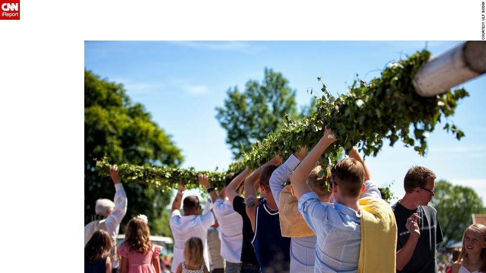 "In Sweden, where Midsummer is one of the biggest celebrations of the year, singing and dancing are central to the fun and frolics. But before all that the maypole has to be decorated and raised. <a href=""http://ireport.cnn.com/people/ulfbodin"" target=""_blank"">Ulf Bodin</a> took this photo in the small town of Sigtuna, an hour north of Stockholm."