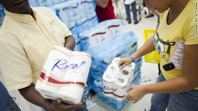 File photo of consumers buying rationed goods during the inauguration of the state-owned Bicentenario supermarket in Caracas in June.
