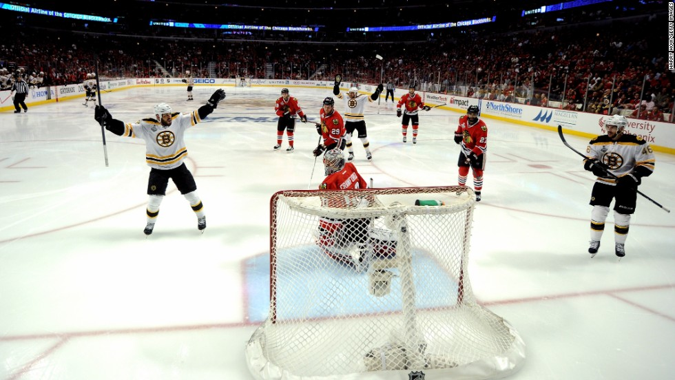 Members of the Boston Bruins celebrate after Milan Lucic, center, scored a goal in the second period.
