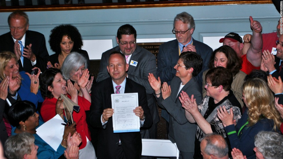 Delaware Gov. Jack Markell holds up legislation on May 7, 2013, allowing same-sex couples to wed in the state.