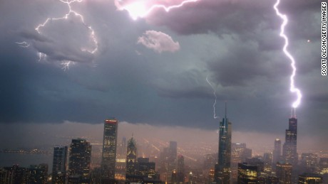 Lightning strikes the Willis Tower in downtown Chicago, on Wednesday, June 12.