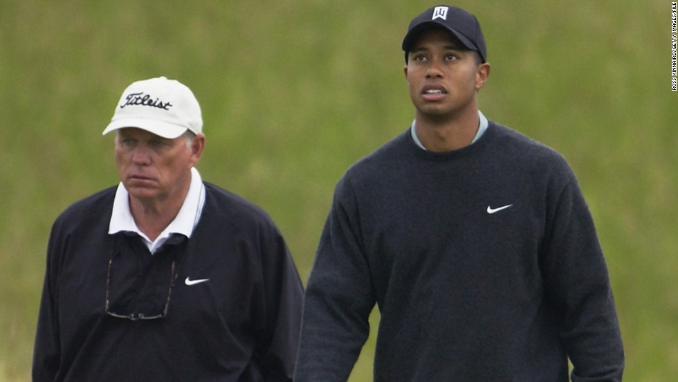 Butch Harmon walks the course with Woods at the British Open in 2002. Harmon turned professional in 1965 and won one event on the PGA Tour before becoming a coach, helping Tiger to the first eight of his 14 major wins.