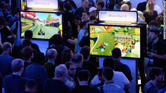 Gamers check out Nintendo's new video games at the Electronic Entertainment Expo (E3) Tuesday in the Los Angeles.