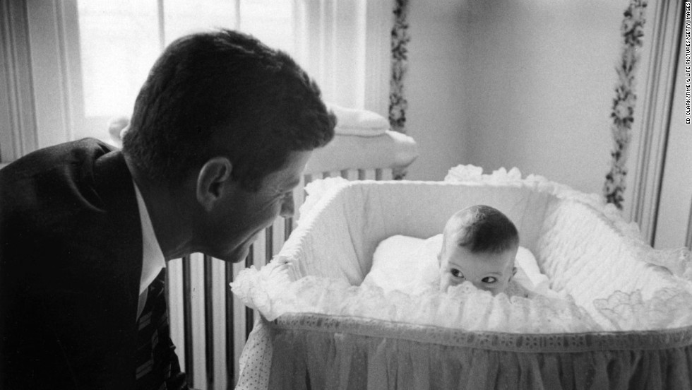 John F. Kennedy with daughter Caroline, 1958.