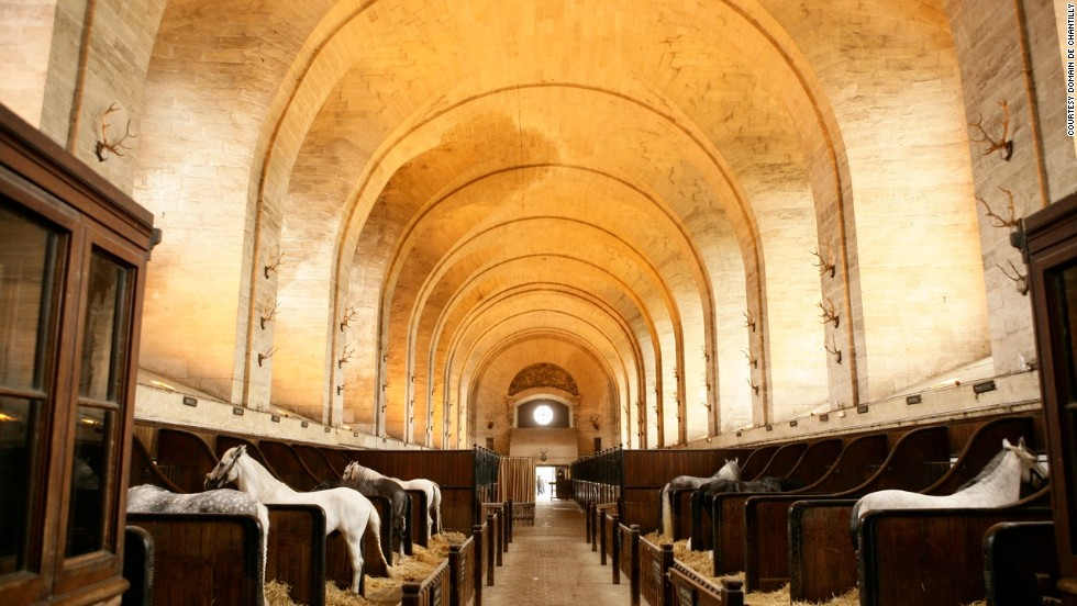Built by Prince Louis-Henri de Bourbon in 1719, the 180-meter-long building was the most impressive stable in the world, housing 250 horses and 300 hunting dogs.