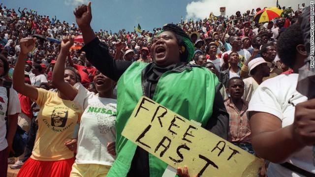 Jubilant residents of Soweto wait to hear newly freed Nelson Mandela speak at Orlando stadium February 12,1990. I