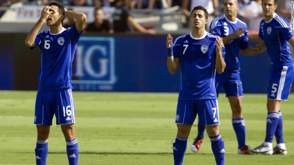 Israel's Jewish player Eran Zahavi (L) and Muslim player Beram Kayal (R) pray before the start of a Euro 2012 qualifier in 2011. The Under-21 squad which competed in this year's European Championship Finals included five Israel-Arabs, two Ethiopians and a Bedouin.