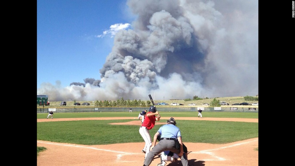 A baseball game goes on despite a raging wildfire in Colorado on Wednesday, June 12.