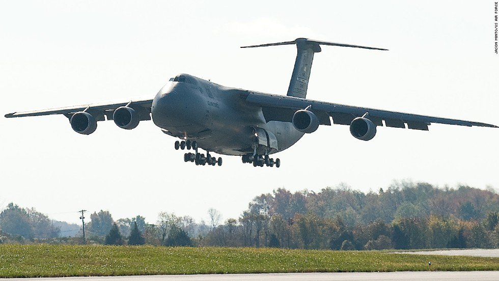 "Dover's fleet includes the<a href=""http://www.af.mil/information/factsheets/factsheet.asp?id=84"" target=""_blank""> C-5M Super Galaxy</a>, a four-engine, 65-foot-high behemoth that can tote quite a load: 270,000 pounds, to be exact. This thing has wings spanning 223 feet and 28 wheels to help it land smoothly. Its distinctive T-tail makes it easy to identify."