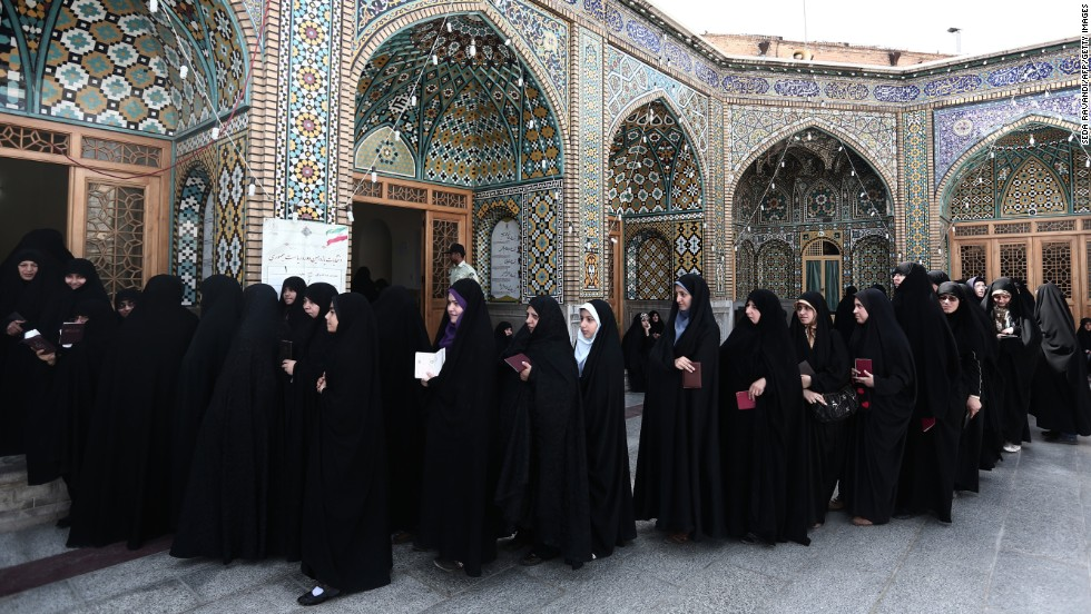Women wait in line to vote at a shrine in Qom on June 14.