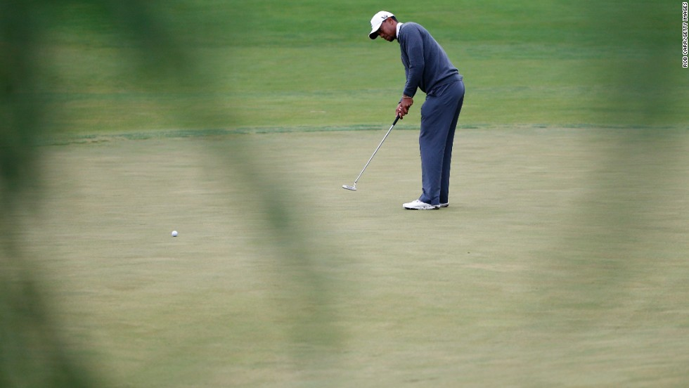 Tiger Woods of the United States putts on the 14th hole on June 14.