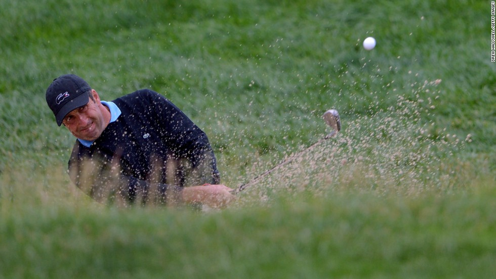 Jose Maria Olazabal of Spain hits his second shot on the 17th hole on June 14.