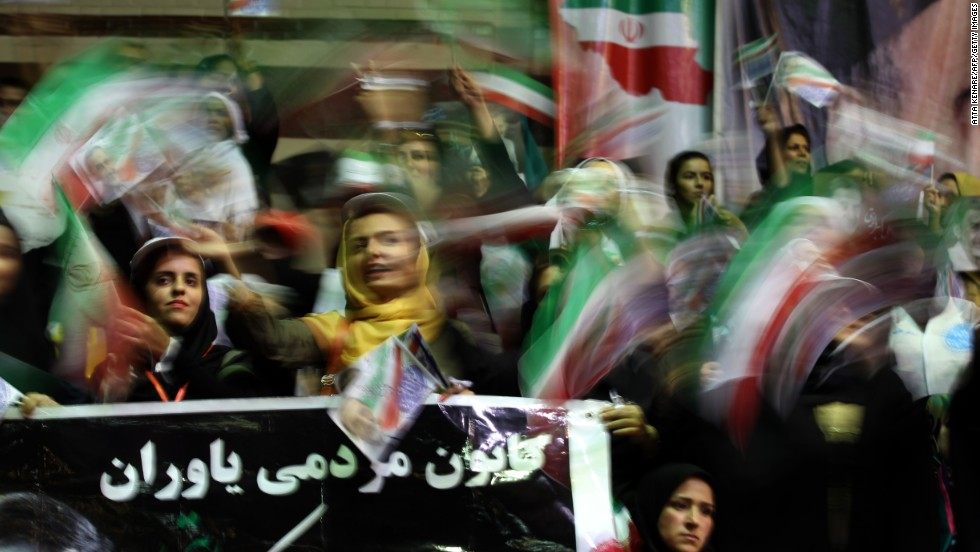 "JUNE 14, TEHRAN, IRAN: Supporters of Iranian adviser to the supreme leader Ayatollah Ali Khamenei and conservative presidential candidate, Ali Akbar Velayati, attend his campaign rally on June 12. Khamenei's vote officially opened the ballots as he called on the 50 million Iranians eligible to <a href=""http://cnn.com/2013/06/14/world/meast/iran-elections/index.html?hpt=hp_t2"">vote in the ""epic"" election.</a>"