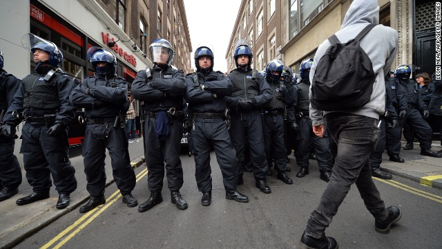 Security is high in London ahead of the G8 summit in Northern Ireland. Riot police stand guard as protests start.