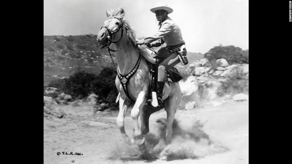 Moore dismounts from a gallop while playing the Lone Ranger.