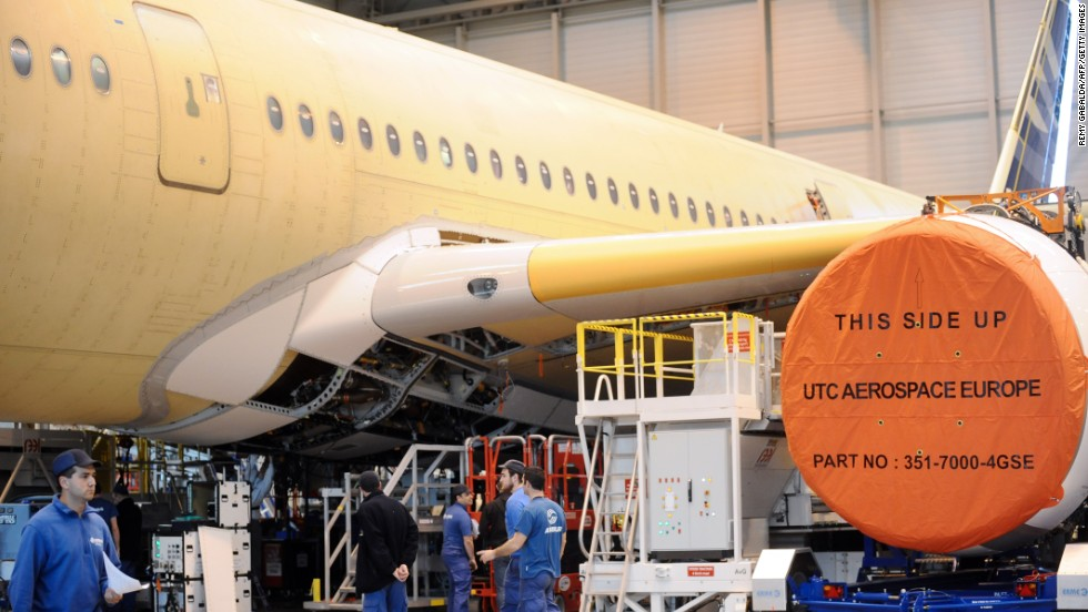 Technicians work on an A350-900 Airbus plane. Over 70% of the A350 XWB's airframe is made from advanced materials that combine composites (53%), titanium and advanced aluminum alloys.