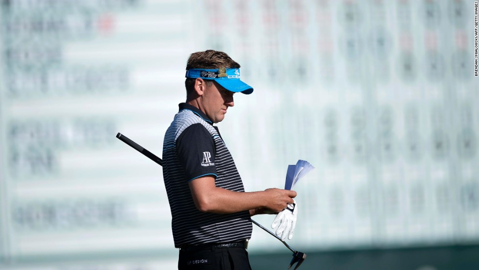 Ian Poulter of England waits to putt on the 18th green on June 15.