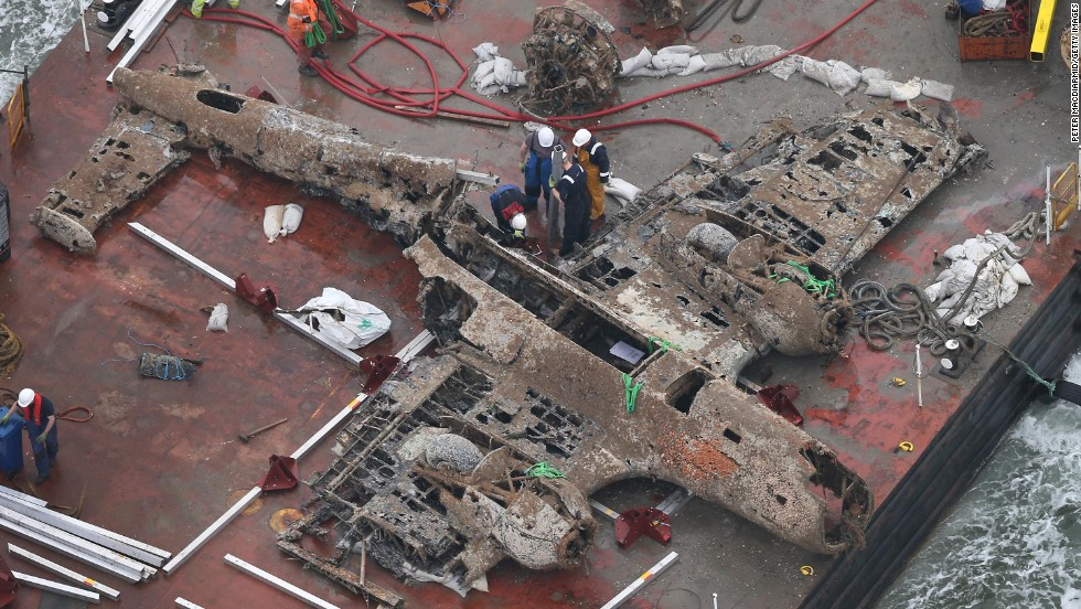 The wreck of the German World War II Dornier Do-17 plane is transported on a barge to a harbor near Ramsgate, England, on Tuesday, June 11. The bomber was shot down during the Battle of Britain in 1940.