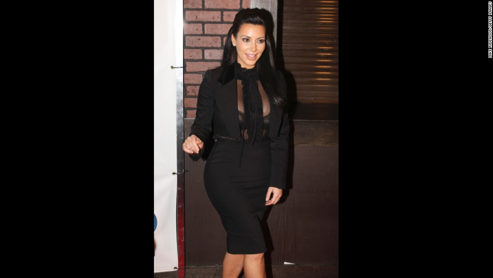 Kim Kardashian wears a revealing blouse in January.