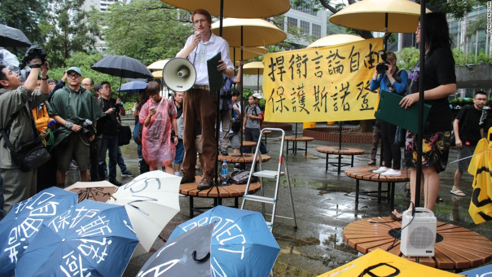 """We're rallying in order not to disappoint him and to ask Hong Kong to protect his well-being, not to extradite him, and to uphold Hong Kong law,"" said blogger-activist and protest co-organizer Tom Grundy (L)."