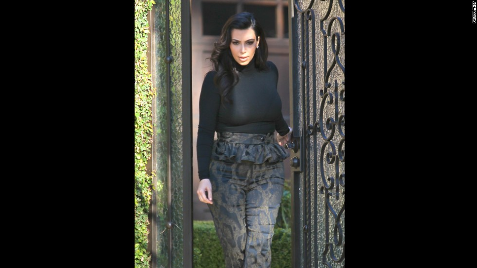Kim Kardashian wears leopard peplum trousers in February.
