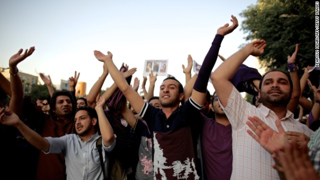 Hassan Rouhani's supporters in Tehran celebrate his victory.