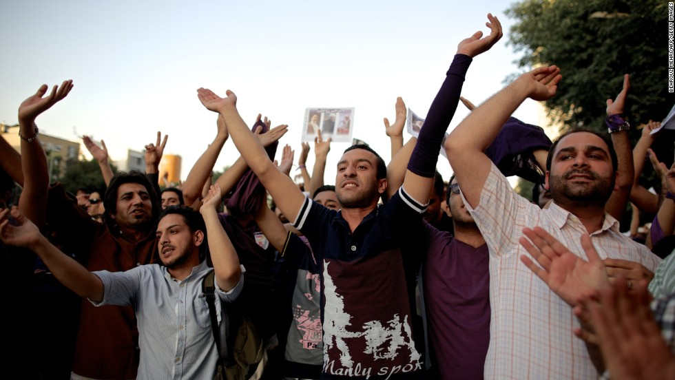 Supporters of Rouhani's celebrate his victory in downtown Tehran on Saturday, June 15.