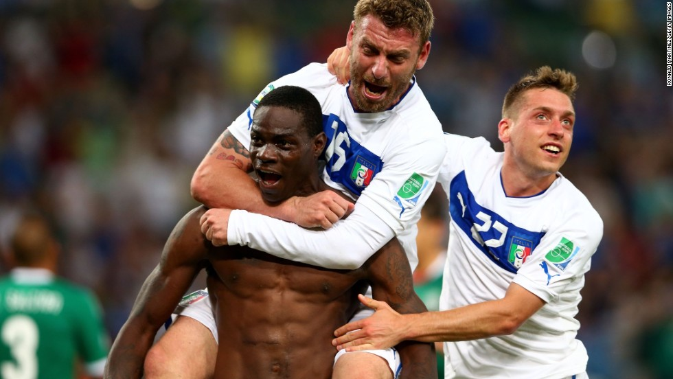 Mario Balotelli celebrates after scoring Italy's winner in the Group A match against Mexico, but was booked for taking his shirt off.