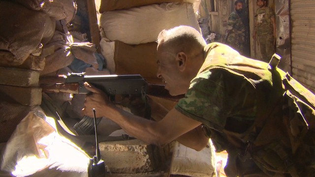 On front line with al-Assad fighters