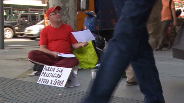 Man hands out resume on Madrid street