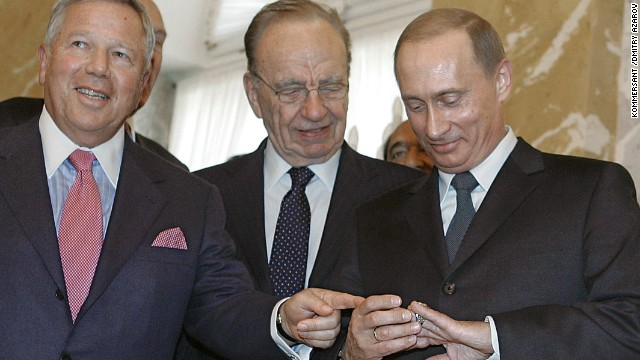 Vladimir Putin shares a laugh with Rupert Murdoch (C) and Robert Kraft (L) in St. Petersburg in 2005.