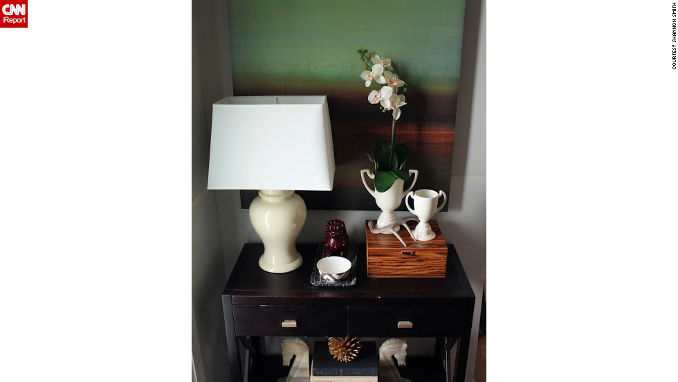 "<a href=""http://ireport.cnn.com/docs/DOC-988240"">Shannon Smith</a>'s foyer in Charlotte, North Carolina, is very small and not well-defined, so she chose a tall painting and an orchid to set her space apart from the living room."