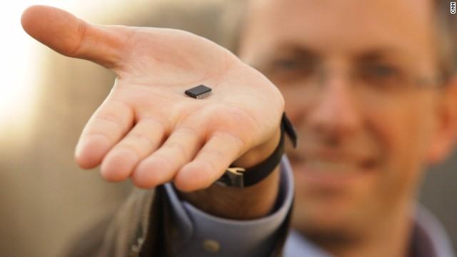 Benedetto Vigna holds a MEMS sensor.