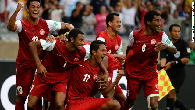 Tahiti's player celebrate Jonathan Tehau's historic goal in their 6-1 defeat to Nigeria in the Confederations Cup.