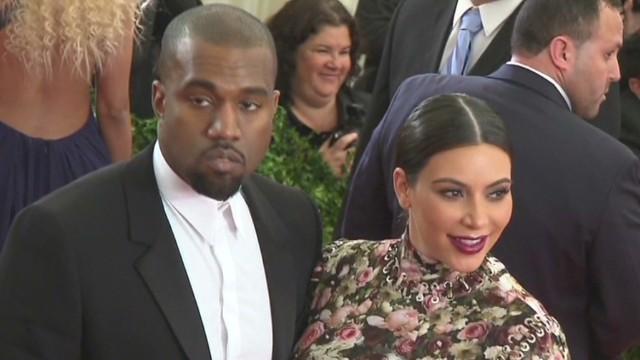 Where was Kanye when Kim gave birth?