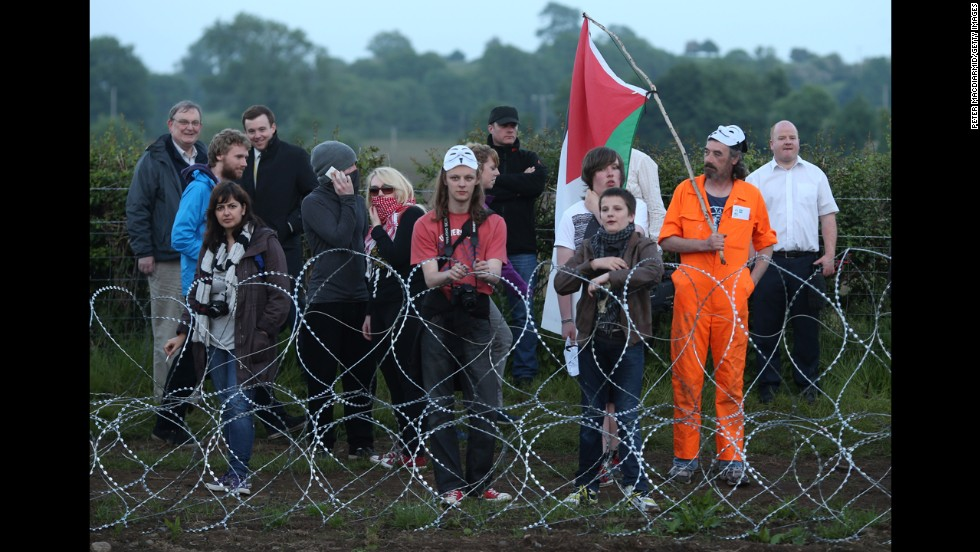 Protesters stand at the outer perimeter of the G8 summit venue at Lough Erne on June 17.