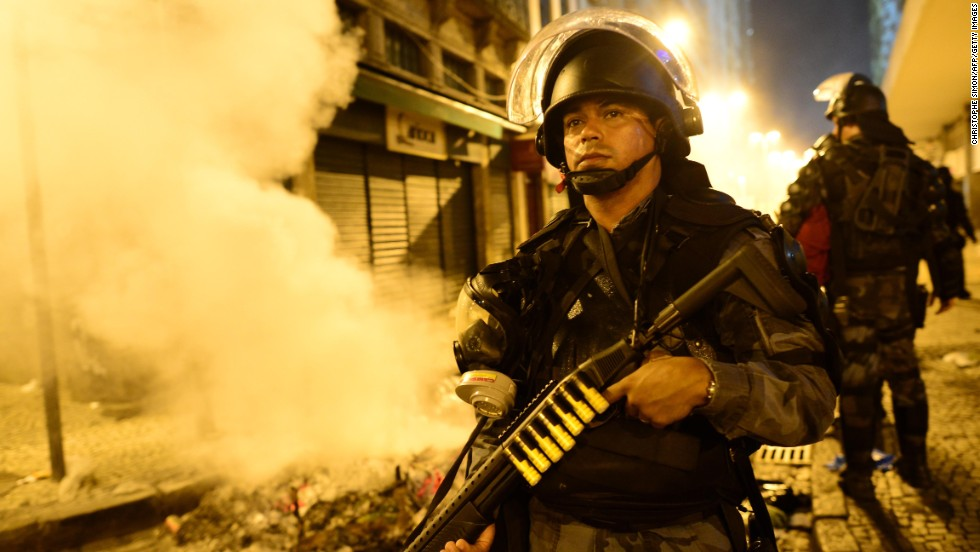 A riot officer holds a position in downtown Rio de Janeiro on June 17.