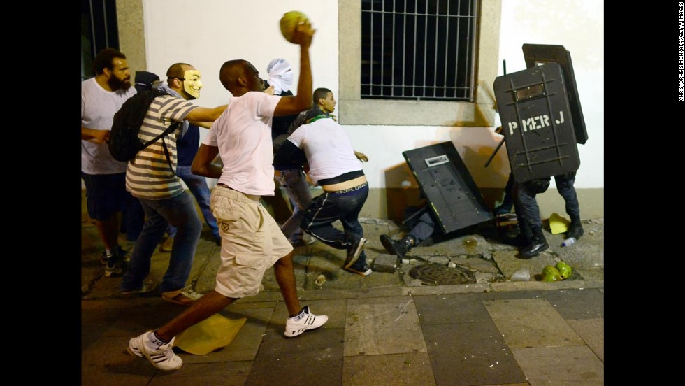 Protesters clash with riot police in front of Rio de Janeiro's Legislative Assembly building on June 17.