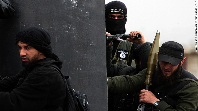 Turkish fighters with an al Qaeda-linked group hold positions in April in the Syrian village of Aziza outside Aleppo.