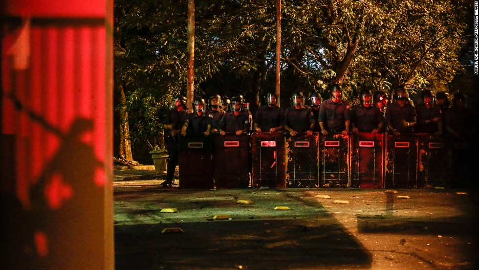 Riot police form a line outside the Government Palace in Sao Paulo, on Monday, June 17.