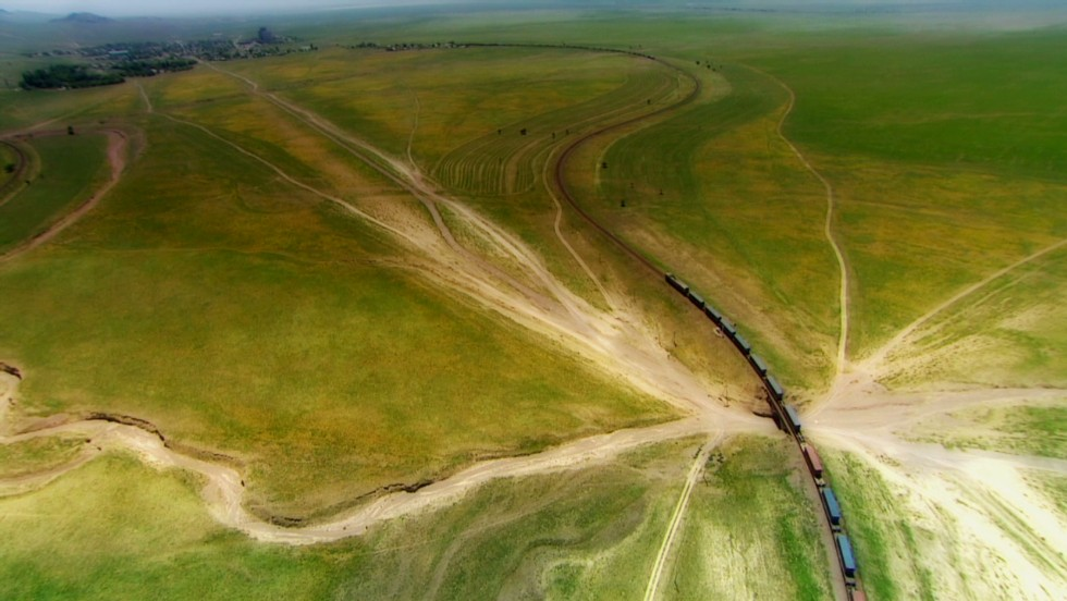 A train heads into the vast hinterland of rural Kazakhstan. An array of other routes for trans-continental rail travel have been identified by the likes of the United Nations Economic and Social Commission for Asia.