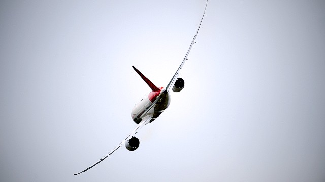 An Air India Boeing 787 Dreamliner flies over Le Bourget airport, near Paris, on June 18, 2013 during the 50th International Paris Air show. AFP PHOTO / ERIC FEFERBERGERIC FEFERBERG/AFP/Getty Images. S023258018