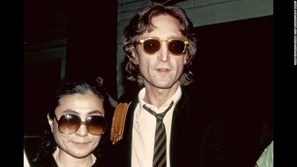"On December 8, 1980, an armed man, Mark Chapman, staked out the Manhattan apartment building where former Beatle John Lennon lived with his wife, Yoko Ono, and their young son. After receiving a signed copy of Lennon's latest album as the singer was leaving his home, Chapman waited until the couple returned to the apartment that night and shot Lennon in the back with a revolver. In this photo taken earlier that year, Lennon and Ono stand outside of the recording studio where he recorded his final album ""Double Fantasy."""