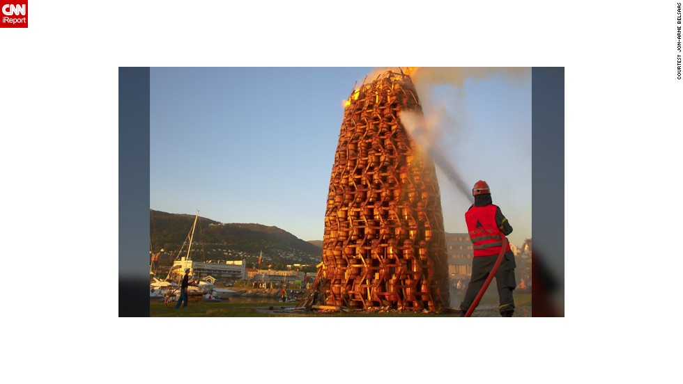 """The bonfires are also one of the highlights during Norwegian midsummer, or 'Sankthansaften'. This photo taken by <a href=""""http://ireport.cnn.com/people/INFERNALelf"""" target=""""_blank"""">Jon-Arne Belsaas</a> in 2009 shows one of the world's largest bonfire made of barrels. He had hurried back to the town of Bergen from his work on a Navy ship to witness it. """"I wanted to catch this magnificent sight,"""" he says."""