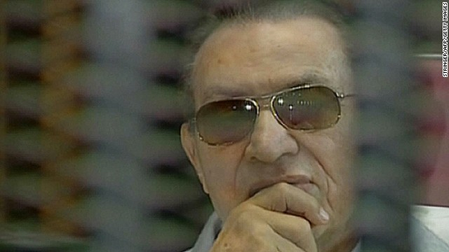 An image grab from state TV Al-Masriya shows ousted president Mubarak during his retrial in Cairo, Egypt, on June 8.